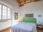 Camera matrimoniale verde in villa